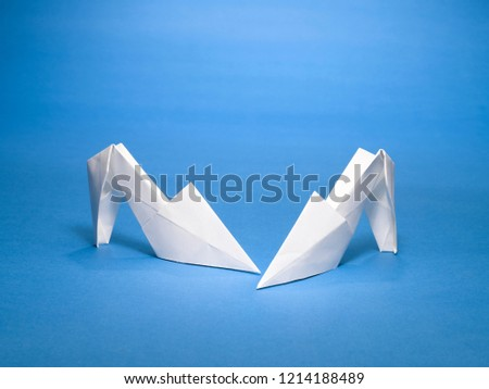 A STILL LIFE OF A PAPER SHOE MADE WITH THE ART OF ORIGAMI  #1214188489