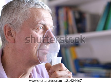 close-up of an old man doing inhalation #121424467