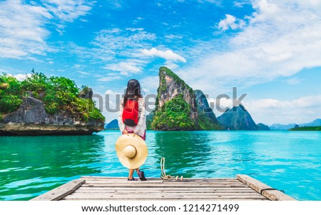 Adventure traveler young woman joy view beautiful destination island Phang-Nga bay, Famous landmark travel place Phuket Thailand, Tourism natural scenic landscape Asia, Tourist summer holiday vacation #1214271499