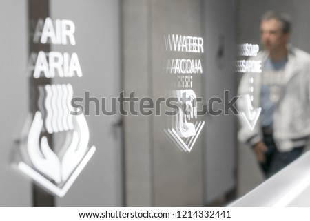 Detail of public bathroom in Italy, with innovative soap / water / air dispensing system (bilingual Italian / English)). Paper saving. ecological concept. #1214332441