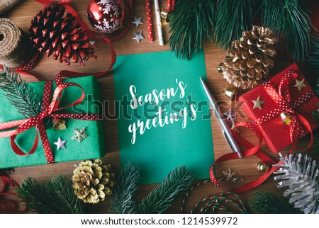 Season's greeting's concepts with cards and gift box present,ornament element on wood table background.Merry christmas and winter collection images Royalty-Free Stock Photo #1214539972