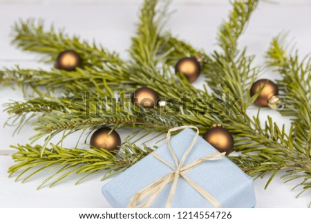 Christmas presents with a spruce twig and decorations on a white background #1214554726