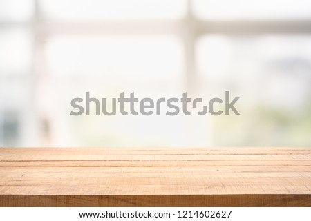 Blur background of white window glass and green view from garden with epty of wood table. Using for Mock up template for craft display of your design,Banner for advertise of product. #1214602627
