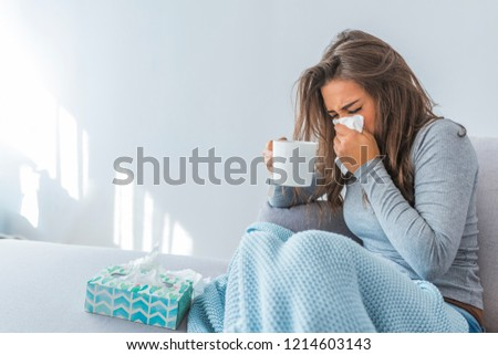 Cold And Flu. Portrait Of Ill Woman Caught Cold, Feeling Sick And Sneezing In Paper Wipe. Closeup Of Beautiful Unhealthy Girl Covered In Blanket Wiping Nose. Healthcare Concept. High Resolution #1214603143