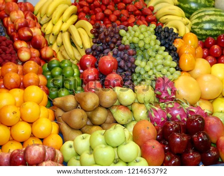 Background from freshly picked apples, pears, bananas, grapes, strawberries, cranberries, lemons, melons, raspberries, currants, blackberries, peaches, gooseberries, apricots, peaches #1214653792