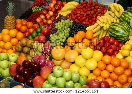 Background from freshly picked apples, pears, bananas, grapes, strawberries, cranberries, lemons, melons, raspberries, currants, blackberries, peaches, gooseberries, apricots, peaches #1214655151
