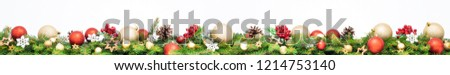 Extra wide Christmas border with golden and red baubles, fir branches, pine cones and red rowan isolated on white background. #1214753140