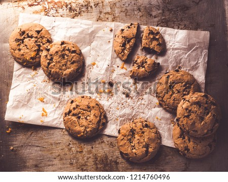 image shows a baking tray or cookie sheet with chocolate chip cookies - topview #1214760496