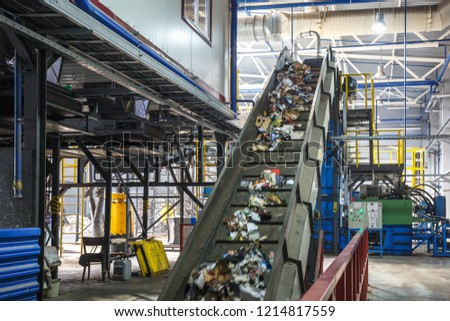moving conveyor transporter on Modern waste recycling processing plant. Separate and sorting garbage collection. Recycling and storage of waste for further disposal.  #1214817559