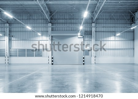 Roller shutter door and concrete floor outside factory building for industry background. #1214918470