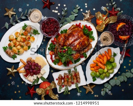 Concept of Christmas or New Year dinner with roasted chicken and various vegetables dishes. Top view. #1214998951