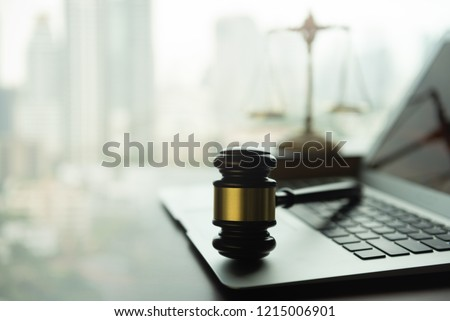 law legal technology concept. judge gavel and computer on desk of lawyer with legal icon. #1215006901