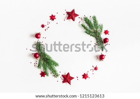 Christmas composition. Fir tree branches, red and green decorations on white background. Christmas, winter, new year concept. Flat lay, top view, copy space #1215123613