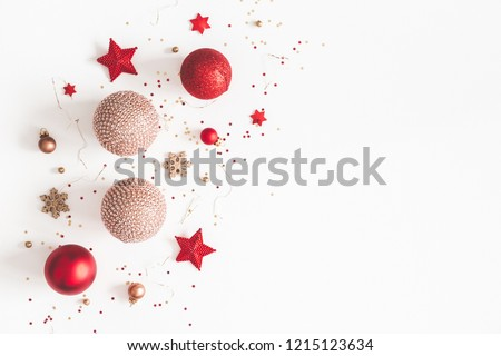 Christmas composition. Christmas red and golden decorations on white background. Flat lay, top view, copy space #1215123634