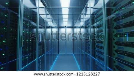 Shot of a long hallway full server racks in a modern data center #1215128227