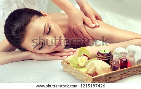 Massage and body  care. Spa body massage   woman hands treatment. Woman having massage in the spa salon for beautiful girl  #1215187426
