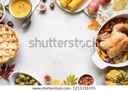 Thanksgiving dinner with chicken, apple pie, pumpkin soup brussel sprouts and fruits. Traditional autumn food concept. Flat lay.  #1215316195