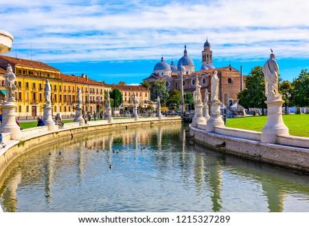 View of canal with statues on square Prato della Valle and Basilica Santa Giustina in Padova (Padua), Veneto, Italy #1215327289