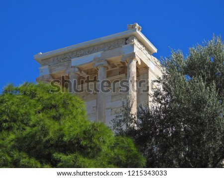 Zoom detail photo of iconic temple of Athena Nike in Propylaia with beautiful clouds and blue sky, Acropolis hill, Athens historic center, Attica, Greece #1215343033