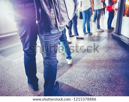 People in queue waiting for something. Back of man and woman Orderly in line with defocus Royalty-Free Stock Photo #1215378886