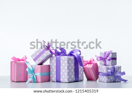 Boxes with gifts in festive pink wrapping paper and paper polka dot, preparing for  holiday. Bright background for card, flyer, invitation, poster, voucher or banner. Copy space.