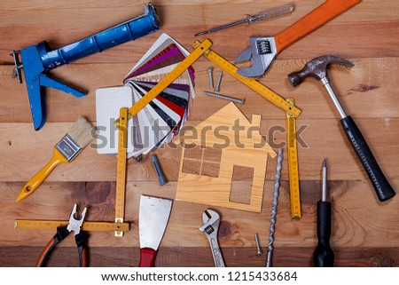 Repair supplies. Tools on the table and board. #1215433684