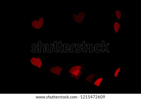 Red lights bokeh.  Abstract background.  Heart-shaped bokeh.  Express love.  Valentine background. #1215472609