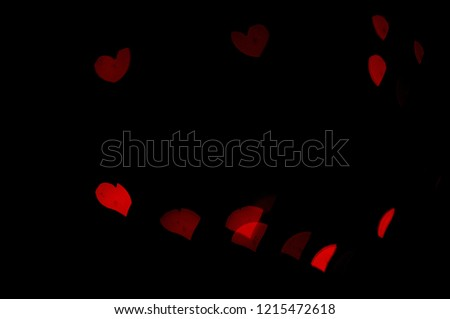 Red lights bokeh.  Abstract background.  Heart-shaped bokeh.  Express love.  Valentine background. #1215472618