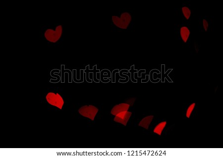 Red lights bokeh.  Abstract background.  Heart-shaped bokeh.  Express love.  Valentine background. #1215472624