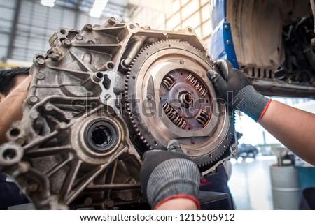Hands of car mechanic working in auto repair service. #1215505912
