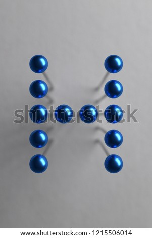 Letter H composed of blue spherical head pins. 3D rendering #1215506014