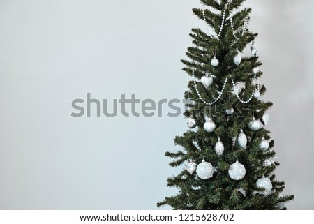 Silver Christmas balls on the Christmas tree in the new year 2019 #1215628702