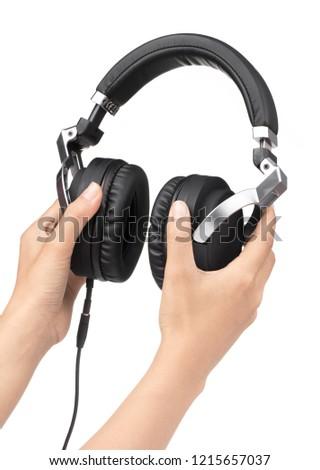 hand holding Headphones Isolated on White Background #1215657037