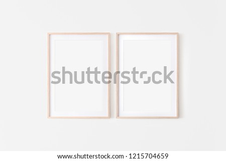 Set of 2 Wooden large 50x70, 20x28, a3,a4, frame mockup with mat on white wall. Poster mockup. Clean, modern, minimal frame. Empty fra.me Indoor interior, show text or product Royalty-Free Stock Photo #1215704659