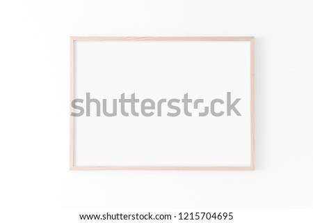 Landscape large 50x70, 20x28, a3,a4, Wooden frame mockup on white wall. Poster mockup. Clean, modern, minimal frame. Empty fra.me Indoor interior, show text or product