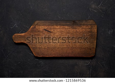 Empty old cutting board on a black background. Layout for the recipe. #1215869536