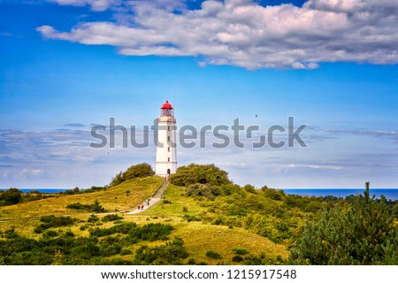 Dornbusch Lighthouse located in the north of the German island of Hiddensee in the Baltic Sea at sunny weather #1215917548