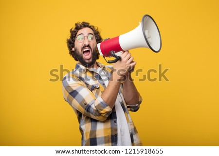 young crazy mad man  fool pose with a megaphone. announcement concept #1215918655