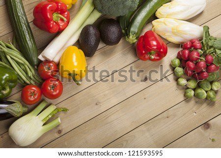 Vegetables on wooden surface #121593595