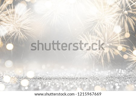 Gold and silver Fireworks and bokeh in New Year eve and copy space. Abstract background holiday.