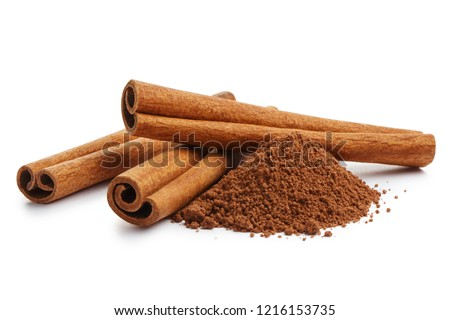 Cinnamon sticks and powder, isolated on white background Royalty-Free Stock Photo #1216153735