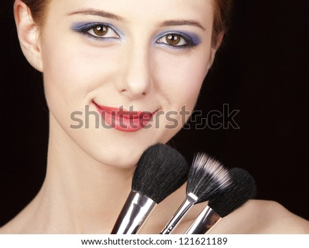 Portrait of beautiful redhead girl with style make-up and brush. #121621189