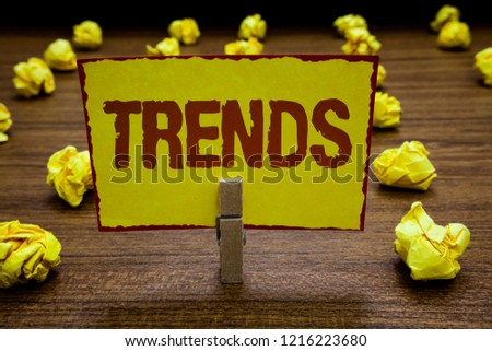 Writing note showing Trends. Business photo showcasing general direction in which something is developing or changing Clothespin holding yellow paper note crumpled papers several tries.
