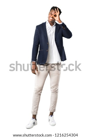 Full body of Handsome african american man wearing a jacket makes funny and crazy face emotion on white background #1216254304