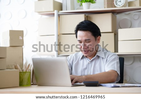 Young Asian Business man was disappointed upset and worry with his business online shopping and cargo import/export at office #1216469965