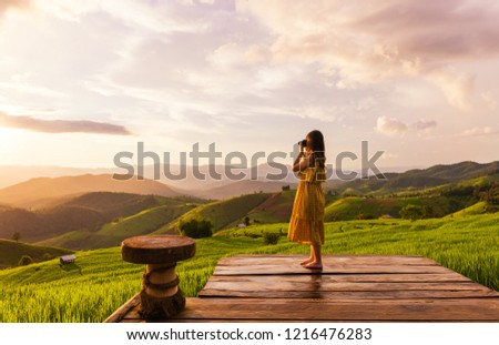 Young woman relaxing in green rice terraces on holiday at pabongpaing village, Mae-Jam Chiang mai, Thailand #1216476283