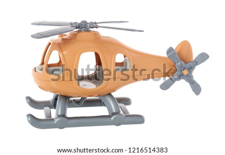 Plastic toy helicopter isolated on white background. Yellow helicopter.