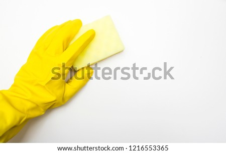 Hand of a worker in a protective glove, the process of cleaning, cleaning the premises. Concept of regular cleaning offices #1216553365