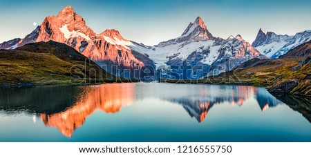 Fantastic evening panorama of Bachalp lake / Bachalpsee, Switzerland. Picturesque autumn sunset in Swiss alps, Grindelwald, Bernese Oberland, Europe. Beauty of nature concept background.