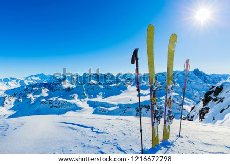Ski in winter season, mountains and ski touring backcountry equipments on the top of snowy mountains in sunny day, Verbier Switzerland. #1216672798